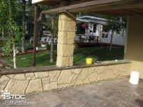 stamped vertical concrete border wall