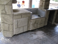 outdoor concrete barbeque area