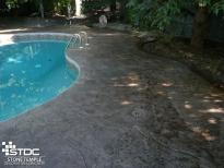 coloured concrete surrounding pool